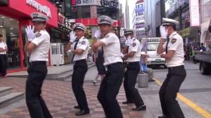 "A popular YouTube video of policemen in Busan performing ""Bar Bar Bar"""